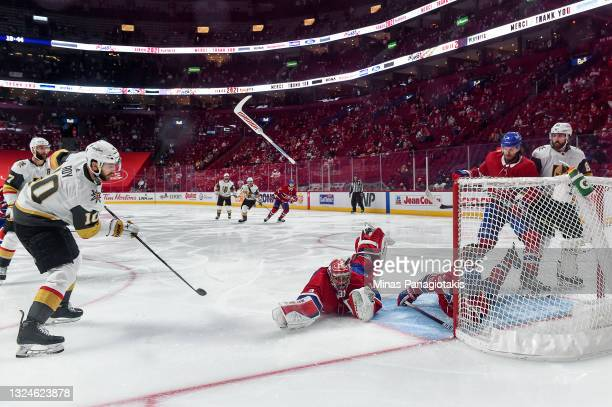 Nicolas Roy of the Vegas Golden Knights scores the game-winning goal past Carey Price of the Montreal Canadiens during the first overtime period in...