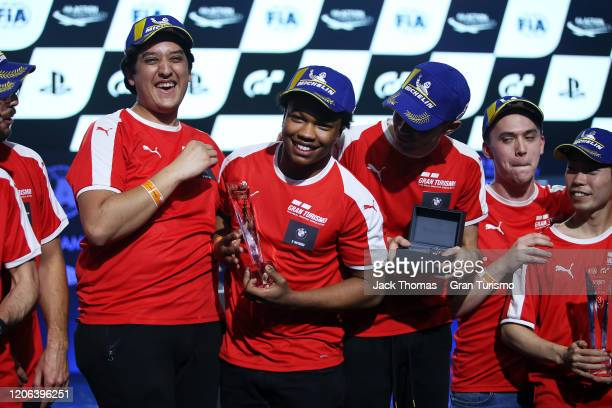 Nicolas Rubilar of Chile Randall Haywood of the United States and Coque Lopez of Spain and team BMW celebrate on the podium after winning the...