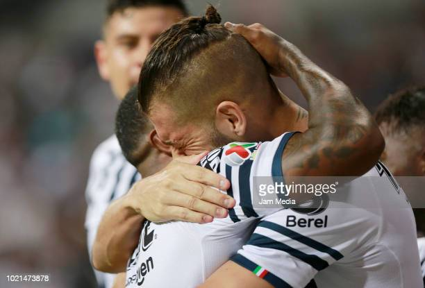 Nicolas Sanchez and Dorlan Pabon of Monterrey the first goal of their team during the fifth round match between Monterrey and Pumas UNAM as part of...