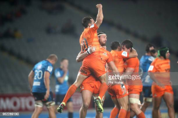 Nicolas Sanchez and Javier Ortega Desio of the Jaguares celebrate on the final whistle during the Super Rugby round 11 match between the Blues and...