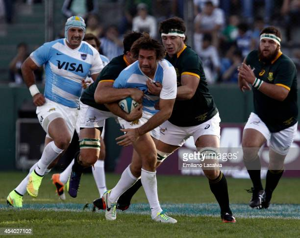 Nicolas Sanchez carries the ball against Francois Louw of South Africa during a match between Argentina and South Africa as part of The Rugby...