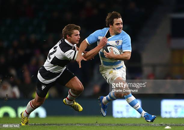 Nicolas Sanchez of Argentina looks to break away from Barbarians Pat Lambie during the Killik Cup match between Barbarians v Argentina at Twickenham...