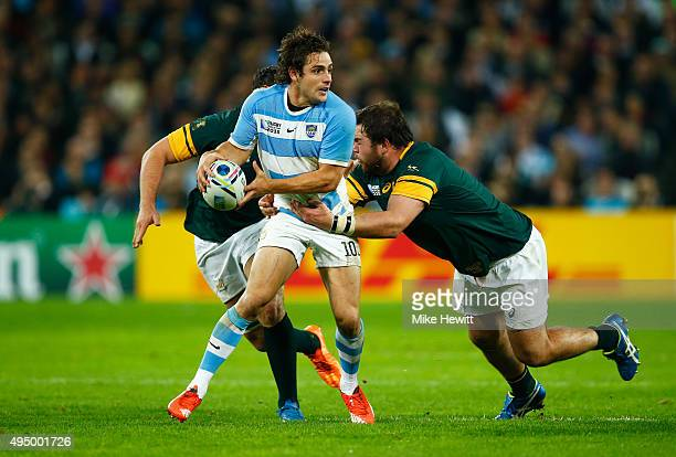 Nicolas Sanchez of Argentina looks to offload as he is tackled during the 2015 Rugby World Cup Bronze Final match between South Africa and Argentina...