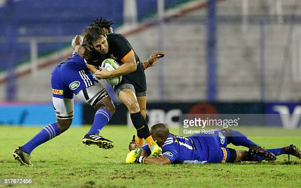Nicolas Sanchez of Jaguares fights for the ball with Siyamthanda Kolisi of Stormers during the 2016 Super Rugby match between Jaguares and Stormers...