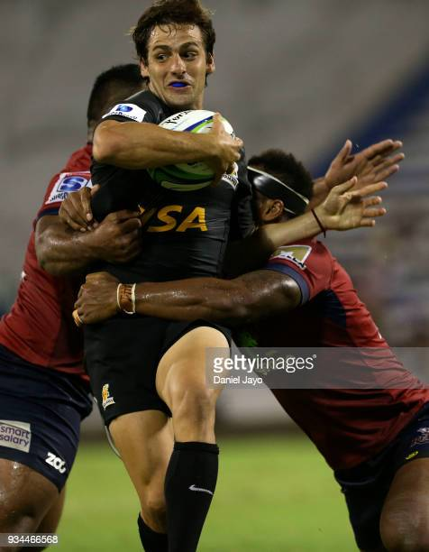 Nicolas Sanchez of Jaguares is tackled by Taniela Tupou of Reds and Samu Kerevi of Reds during a match between Jaguares and Reds as part of the fifth...