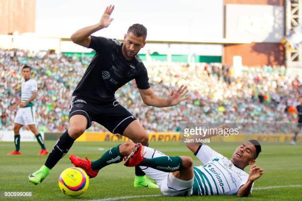 Nicolas Sanchez of Monterrey and Jose Juan Vazquez of Santos fight for the ball during the 11th round match between Santos Laguna and Monterrey as...