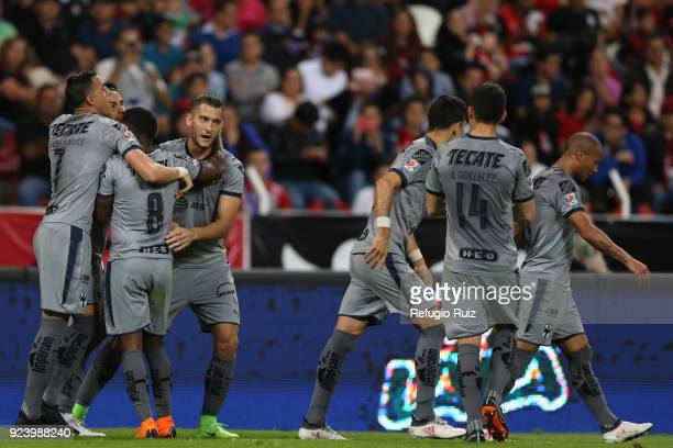 Nicolas Sanchez of Monterrey celebrates with teammates after scoring the first goal of his team during the 9th round match between Atlas and...