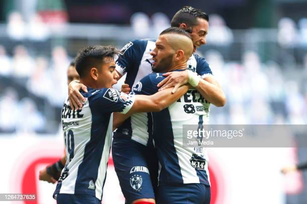 Nicolas Sanchez of Monterrey celebrates with teammates Carlos Rodriguez and Rogelio Funes Mori after scoring the first goal of his team during the...