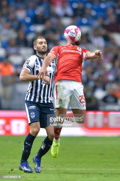 Nicolas Sanchez of Monterrey fights for the ball with Pedro Canelo of Toluca during the 13th round match between Monterrey and Toluca as part of the...