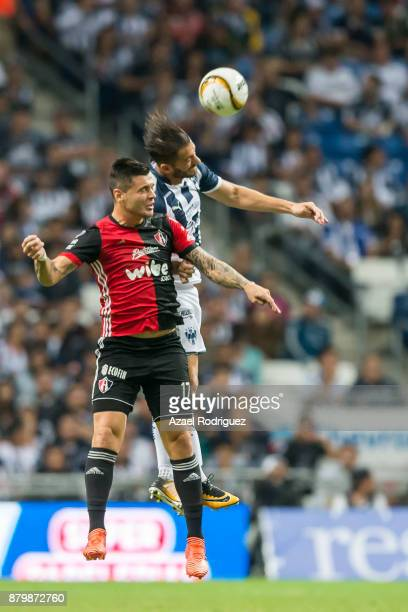 Nicolas Sanchez of Monterrey heads the ball with Milton Caraglio of Atlas during the quarter finals second leg match between Tigres UANL and Leon as...