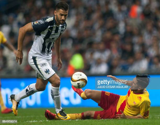 Nicolas Sanchez of Monterrey vies for the ball with Diego Valdez of Morelia during their semifinal Mexican Apertura 2017 tournament football match at...