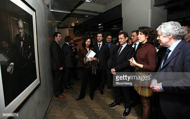 Nicolas Sarkozy admires a portrait of British WWII Prime Minister Winston Churchill at the Cabinet War Rooms in Westminster, UK, Tuesday, Jan. 30,...