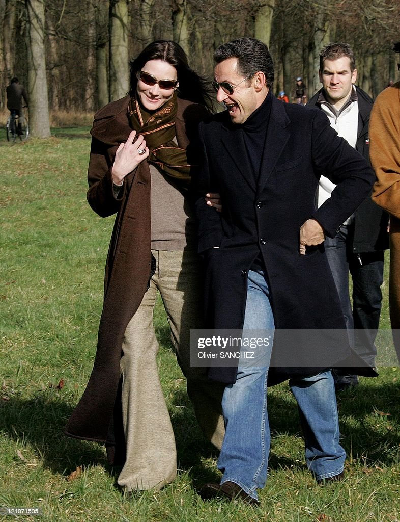 Nicolas Sarkozy And Carla Bruni Are Walking In The Day After Their News Photo Getty Images