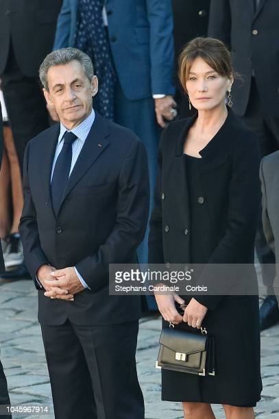 Nicolas Sarkozy and Carla Bruni during the national Tribute to Charles Aznavour at Les Invalides on October 5, 2018 in Paris, France.