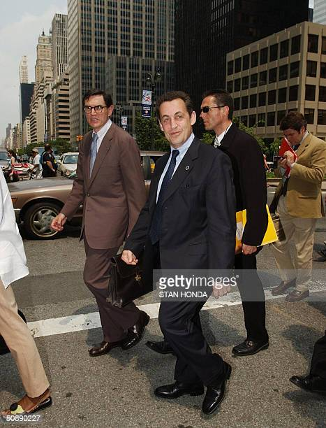 Nicolas Sarkozy Finance Minister of France and Richard Duque the French consul general in New York walk across Park Avenue 23 May 2004 on their way...
