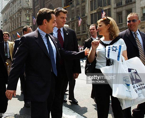 Nicolas Sarkozy Finance Minister of France speaks to a woman holding an Israeli flag 23 May 2004 on a walk up Fifth Avenue during the Salute to...