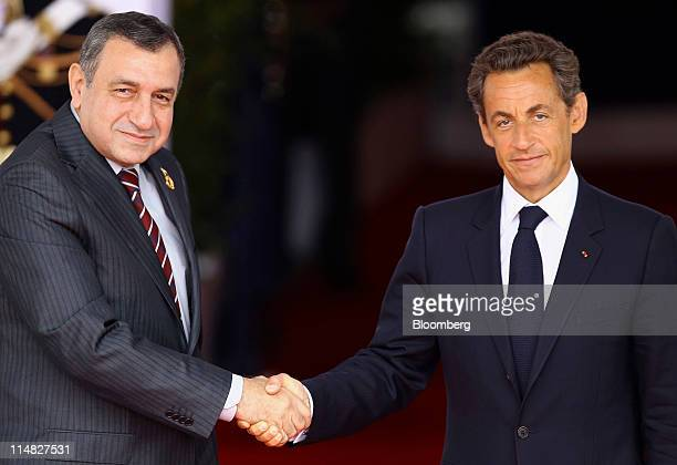 Nicolas Sarkozy France's president right shakes hands with Essam Sharaf Egypt's prime minister during the Group of Eight summit in Deauville France...