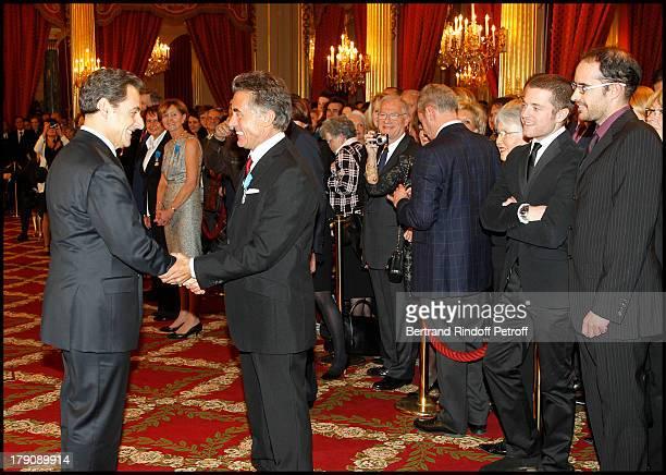 Nicolas Sarkozy Gerard Holtz and his two children Julien and Antoine at Francois Kosciusko Morizet Receives Honour At The Palais De L'Elysee In Paris