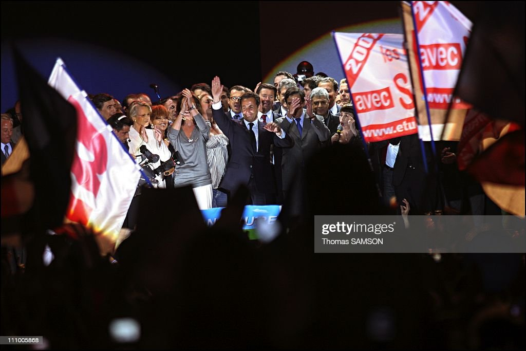 Nicolas Sarkozy gives a speech to his supporters on the Place de la Concorde after his victory at the presidential elections in Paris, France on May 06th, 2007 - Michele Alliot Marie, Cecila and Nicolas Sarkozy.