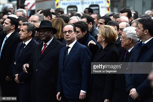 Nicolas Sarkozy Ibrahim boubakar Keita Francois Hollande Angela Merkel Mahmoud Abbas and Matteo Renzi walk during a mass unity rally following the...