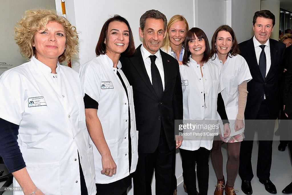 Nicolas Sarkozy (3rd L), Mayor of Nice Christian Estrosi (R) and psychologists attend the inauguration of the Claude Pompidou Institute dedicated to the fight against Alzheimer's disease. In Nice, on March 10, 2014