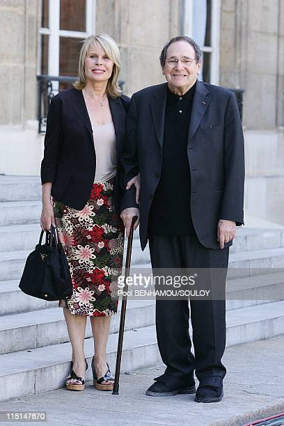 Nicolas Sarkozy receives Ingrid Betancourt at Elysee Palace in Paris France on July 04 2008 Robert Hossein and his wife Candice Patou