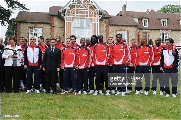Nicolas Sarkozy visits the French soccer team in Clairefontaine France on June 02 2008From Left to right Roselyne Bachelot Patrice Evra Raymond...