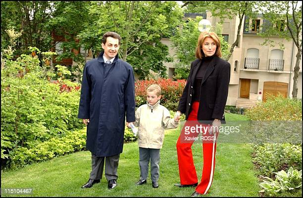 Nicolas Sarkozy votes for the 2nd round of the French presidential election in NeuillysurSeine France on May 05 2002 With her wife Cecilia and their...