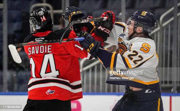 Nicolas Savoie of the Quebec Remparts and Mavrik Bourque of the Shawinigan Cataractes tangle with each other during their QMJHL hockey game at the...