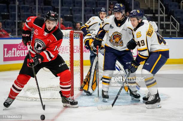 Nicolas Savoie of the Quebec Remparts controls the puck against the Shawinigan Cataractes during their QMJHL hockey game at the Videotron Center on...