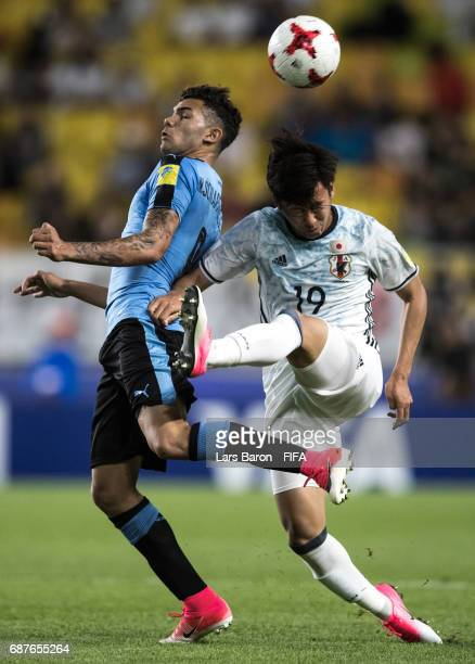 Nicolas Schiappacasse of Uruguay is challenged by Kakeru Funaki of Japan during the FIFA U-20 World Cup Korea Republic 2017 group D match between...