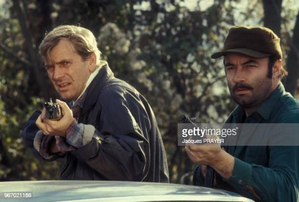 Nicolas Silberg et Gerard Sergue lors du tournage du film 'Mesrine' realise par Andre Genoves le 26 janvier 1984 a Paris France