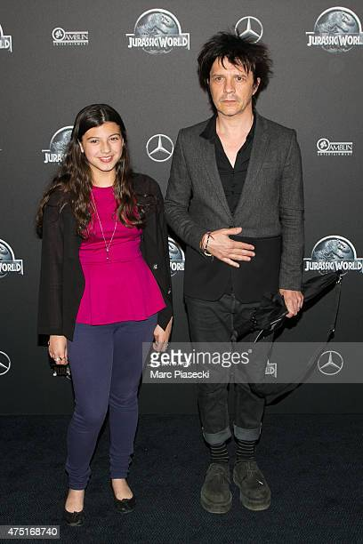 Nicolas Sirkis and daughter Thea Sirkis attend the 'Jurassic World' Premiere at Cinema UGC Normandie on May 29 2015 in Paris France