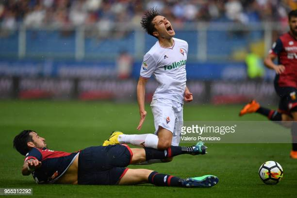 Nicolas Spolli of Genoa CFC tackles Federico Chiesa of ACF Fiorentina during the serie A match between Genoa CFC and ACF Fiorentina at Stadio Luigi...
