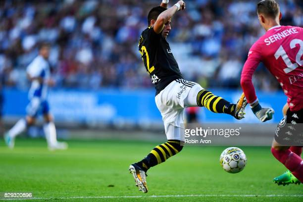 Nicolas Stefanelli of AIK and Pontus Dahlberg goalkeeper of IFK Goteborg competes for the ball during the Allsvenskan match between IFK Goteborg and...