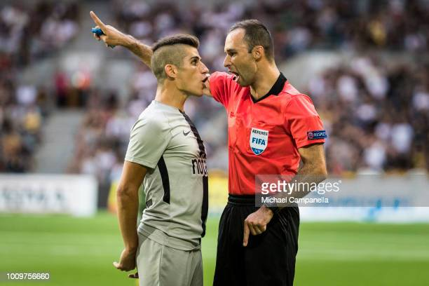 Nicolas Stefanelli of AIK argues with referee Jerome Brisard during a UEFA Europa League second qualifying round match between AIK and FC...