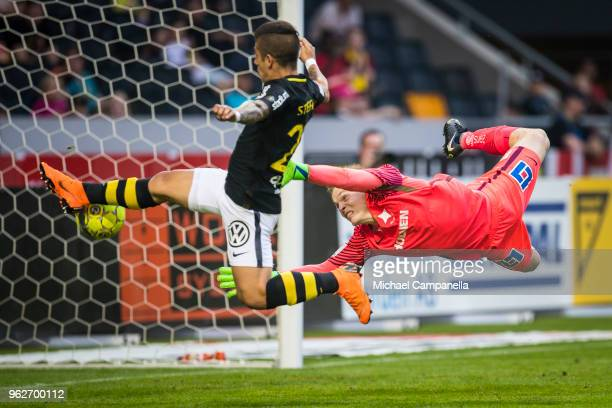 Nicolas Stefanelli of AIK fails to score in front of goal with IFK Norrkoping goalkeeper Isak Pettersson beat during an Allsvenskan match between AIK...