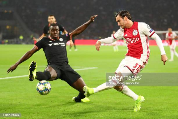 Nicolas Tagliafico of AFC Ajax is closed down by Kurt Zouma of Chelsea during the UEFA Champions League group H match between AFC Ajax and Chelsea FC...