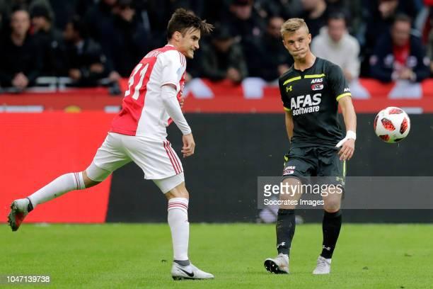 Nicolas Tagliafico of Ajax Albert Gudmundsson of AZ Alkmaar during the Dutch Eredivisie match between Ajax v AZ Alkmaar at the Johan Cruijff Arena on...