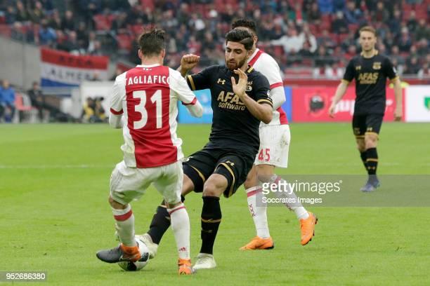 Nicolas Tagliafico of Ajax Alireza Jahanbakhsh of AZ Alkmaar during the Dutch Eredivisie match between Ajax v AZ Alkmaar at the Johan Cruijff Arena...
