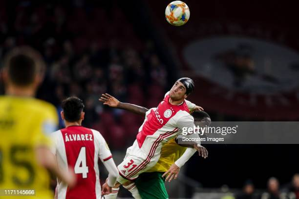 Nicolas Tagliafico of Ajax Amadou Ciss of Fortuna Sittard during the Dutch Eredivisie match between Ajax v Fortuna Sittard at the Johan Cruijff Arena...