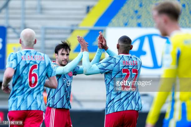 Nicolas Tagliafico of Ajax and Sebastien Haller of Ajax celebrate their sides first goal during the Eredivisie match between RKC Waalwijk and Ajax at...