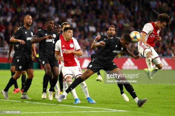 Nicolas Tagliafico of Ajax battles for the ball with Chuba Akpom of PAOK during the UEFA Champions League 3rd Qualifying match between Ajax and PAOK...