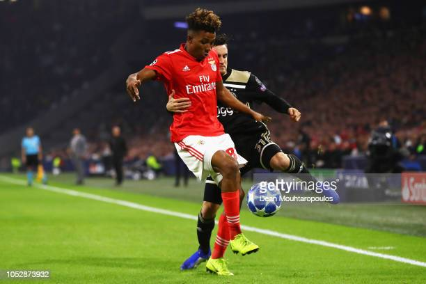 Nicolas Tagliafico of Ajax battles for the ball with Gedson Fernandes of Benfica during the Group E match of the UEFA Champions League between Ajax...