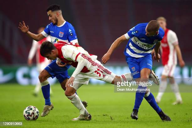 Nicolas Tagliafico of Ajax battles for the ball with Mustafa Saymak and Jesper Drost of PEC Zwolle during the Dutch Eredivisie match between Ajax and...