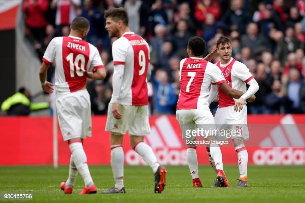 Nicolas Tagliafico of Ajax celebrates 21 with David Neres of Ajax during the Dutch Eredivisie match between Ajax v SC Heerenveen at the Johan Cruijff...