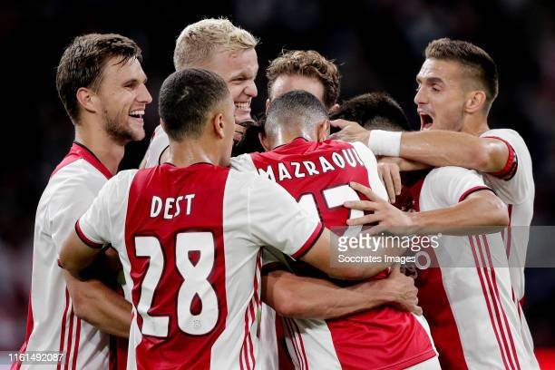 Nicolas Tagliafico of Ajax celebrates 21 with Joel Veltman of Ajax Sergino Dest of Ajax Donny van de Beek of Ajax Daley Blind of Ajax Noussair...