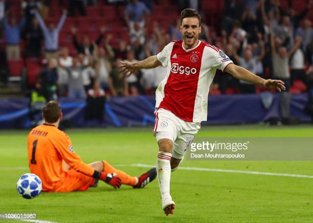 Nicolas Tagliafico of Ajax celebrates after scoring his team's first goal during the Group E match of the UEFA Champions League between Ajax and AEK...