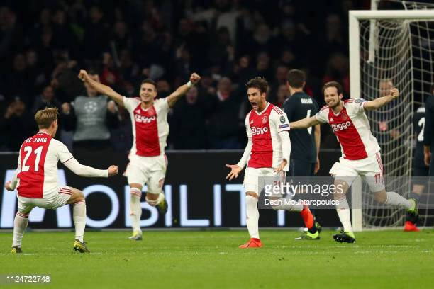 Nicolas Tagliafico of Ajax celebrates after scoring his team's first goal with his team mates but the goal is later disallowed by the VAR during the...