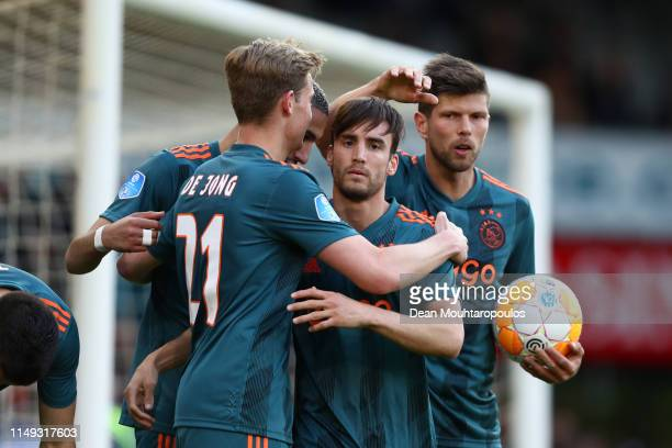 Nicolas Tagliafico of Ajax celebrates with team mates after scoring their team's second goal during the Eredivisie match between De Graafschap and...
